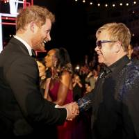 Britain's Prince Harry (left) greets Elton John after the Royal Variety Performance at the Albert Hall in London in 2015. | REUTERS