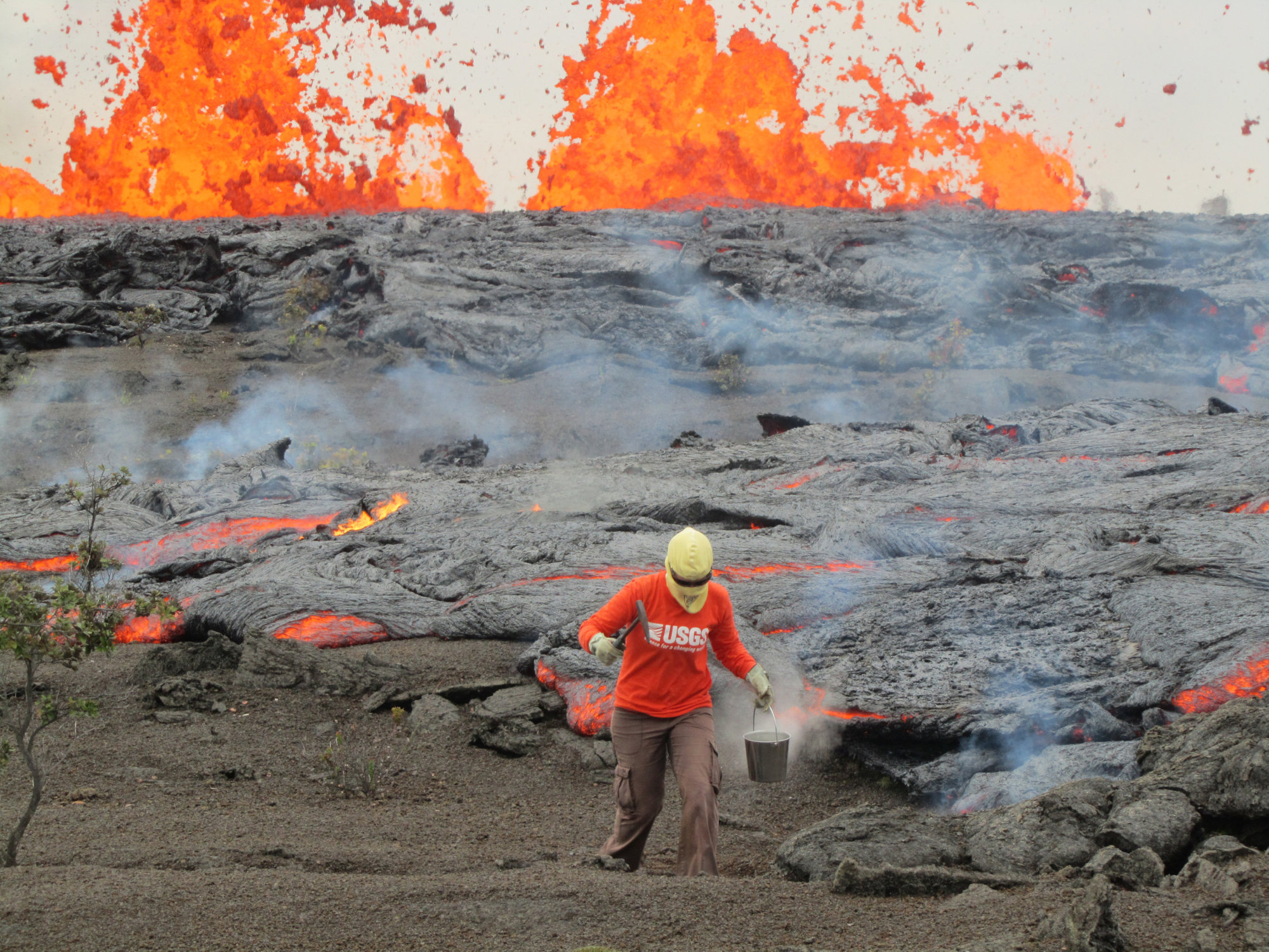 A geologist collects a sample of molten lava from the Kamoamoa eruption at Hawaii's Kilauea volcano in March 2011. | REUTERS