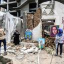 Palestinian artists display artwork in the yard of the damaged Arts an   d Crafts Village, which was hit by Israeli airstrikes two days before, in Gaza City on Monday.