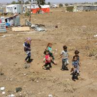 Internally displaced children from Deraa province run together near the Israeli-occupied Golan Heights in Quneitra, Syria, Wednesday.   REUTERS
