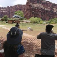 Flash floods force 200 tourists to flee to high ground at Grand Canyon waterfalls