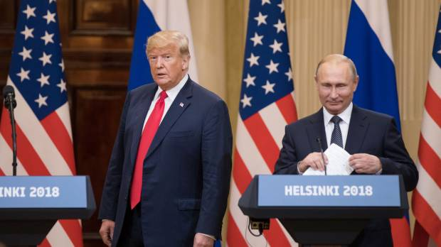 Trump gives Putin a wink as they sit down for closely watched summit