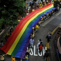 Participants march with a rainbow banner during the annual pride parade in Hong Kong in 2015.   REUTERS