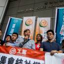 "Pro-democracy lawmaker Au Nok-hin (fourth from left), former lawmakers and pro-democracy activists Lee Cheuk-yan (fifth from left) and Leung Kwok-hung (sixth), also known as ""Long Hair"", attend a protest against the Hong Kong police seeking a ban on the pro-independence Hong Kong National Party, outside the police headquarters in Hong Kong on July 18."