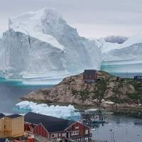 Iceberg 4 miles wide breaks off from Greenland glacier as another threatens to swamp village