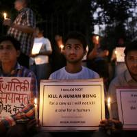 Indians participate in a candlelight vigil in memory of 52-year-old Muslim farmer Mohammad Akhlaq who was lynched by a mob, in New Delhi on Oct. 3, 2015 . India's highest court on Tuesday asked the federal government to consider enacting a law to deal with an increase in mob violence and lynchings that have mostly followed rumors that the victims either belonged to members of child kidnapping gangs or were beef eaters and cow slaughterers. | AP