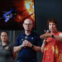Alex Young, solar scientist at NASA's Goddard Space Flight Center (middle), Nicola Fox, Parker Solar Probe project scientist at Johns Hopkins Applied Physics Laboratory (right), and Betsy Congdon, also from the university's APL and a lead engineer on the mission, speak during a briefing at Kennedy Space Center in Cape Canaveral, Florida, on Friday.   REUTERS