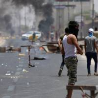 Two demonstrators killed as Iraq protests over basic services, Iran presence hit second week