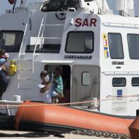 Italy relents, agrees to take in some migrants aboard ships after other EU states offer likewise