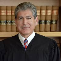 Tempered by prejudice early in life, U.S. judge takes hard line on splitting immigrant families