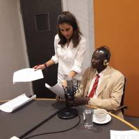 Abdallah Afandi (right), a Sudanese migrant, tapes an episode for the Msh Gharib radio show with the help of journalist Christine Habib in November 2017. | MIGRANT COMMUNITY CENTER OF BEIRUT