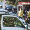 A suspect is arrested after evading police and holding dozens of people hostage inside a Trader Joe's supermarket on Saturday in Los Angeles.