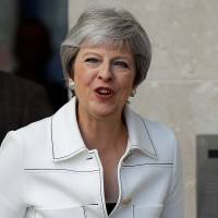 May says Trump advised her to sue EU over Brexit