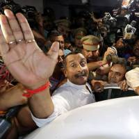Kuldeep Singh Sengar, a legislator of Uttar Pradesh state from India's ruling Bharatiya Janata Party (BJP), reacts as he leaves a court after he was arrested in April in connection with the rape of a teenager, in Lucknow, India. | REUTERS