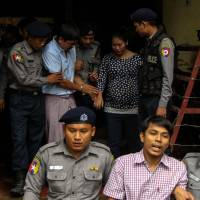 In apparent test of Myanmar democracy, jailed Reuters journalists to testify in court