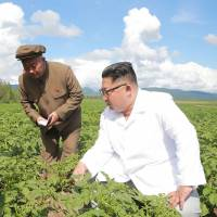 North Korean leader Kim Jong Un inspects a farm in Samjiyon County in this undated picture released Tuesday. | KCNA / KNS / VIA AFP-JIJI