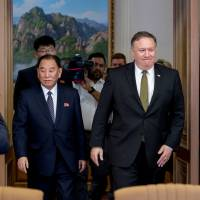 U.S. Secretary of State Mike Pompeo and Kim Yong Chol, a North Korean senior ruling party official and former intelligence chief, return to discussions after a break at Park Hwa Guest House in Pyongyang on Saturday.   REUTERS