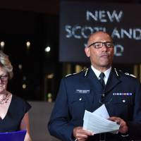 The U.K.'s head of counterterrorism policing, Neil Basu, and chief medical officer for England Dame Sally Davies hold a news conference at New Scotland Yard in London Wednesday. British police say a couple who are critically ill were exposed to the Russian nerve agent Novichok. | JOHN STILLWELL / PA / VIA AP