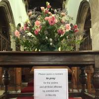 A picture shows a sign urging parishioners to pray for Dawn Sturgess and Charlie Rowley, the couple poisoned by contact with the nerve agent Novichok, inside St Thomas's church in Salisbury on Monday. | AFP-JIJI