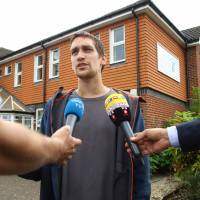 Sam Hobson talks to the media outside the Amesbury Baptist Center in Amesbury, southern England, on Wednesday, identifying himself as a friend of two people who were found unconcious at a residence in the town under circumstances that sparked a major incident. | AFP-JIJI