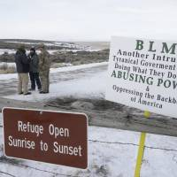 Members of the group occupying the Malheur National Wildlife Refuge headquarters stand guard near Burns, Oregon, in 2016. President Donald Trump on Tuesday pardoned two cattle ranchers convicted of arson in a case that sparked the armed occupation of the national wildlife refuge in Oregon. | AP