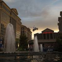 Travis Pastrana jumps the fountain at Caesars Palace on a motorcycle Sunday in Las Vegas. Pastrana re-created three of Evel Knievel's iconic motorcycle jumps on Sunday, including the leap over the fountains of Caesars Palace that left Knievel with multiple fractures and a severe concussion. | AP