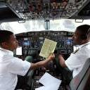 Pilots sit in the cockpit as they prepare Ethiopian Airlines ET314 flight to Eritrea's capital Asmara at the Bole International Airport in Addis Ababa Wednesday.