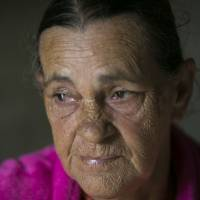 Marta Bermudez Robles is seen at her home, which is still without power since hurricanes Irma and Maria, in Adjuntas, Puerto Rico, on July 12, 2018. The 66-year-old does not believe the government has enough resources to properly rebuild the power grid amid an 11-year recession. | AP