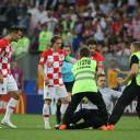 Players from the Croatian team stand by as security guards remove a protester from the pitch during the FIFA World Cup final match in Moscow on Sunday.