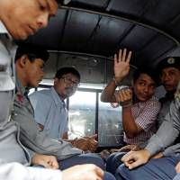 Myanmar court charges Reuters reporters with violating colonial-era secrets act