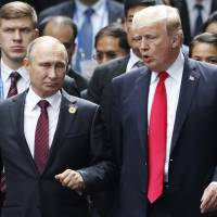 Indictment of Russian officers puts pressure on Trump to raise issue of election meddling at summit with Putin