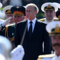 Putin attends Navy Day event, says Russian force to get 26 new vessels this year