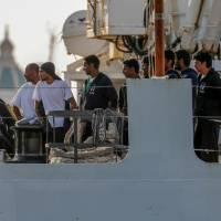 The Italian Coast Guard ship Diciotti, with 67 migrants on board rescued four days earlier by the freighter Vos Thalassa, is moored in the Sicilian port of Trapani, southern Italy, Thursday. The coast guard ship is still awaiting permission to disembark its 67 migrants, after two of them were accused of threatening their rescuers if they were taken back to Libya. | IGOR PETYX / ANSA / VIA AP