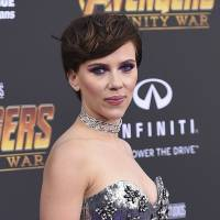 Scarlett Johansson arrives at the world premiere of 'Avengers: Infinity War' in Los Angeles in April. Johansson's plans to portray a transgender man has sparked a backlash from many who object to cisgender actors playing trans roles. Earlier this week, Johansson was announced to star in the film 'Rub & Tug,' about prostitution ring leader Dante 'Tex' Gill,' who was born Lois Jean Gill but identified as a man. Since then, many transgender actors and advocates have criticized the production for Johansson's casting. | JORDAN STRAUSS / INVISION / VIA AP