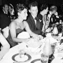 """Frank Sinatra looks at the Oscar he won for his performance in the film """"The House I Live In"""" as his wife, Nancy, sits beside him at Ciro's nightclub on Sunset Boulevard in West Hollywood on March 11, 1946."""