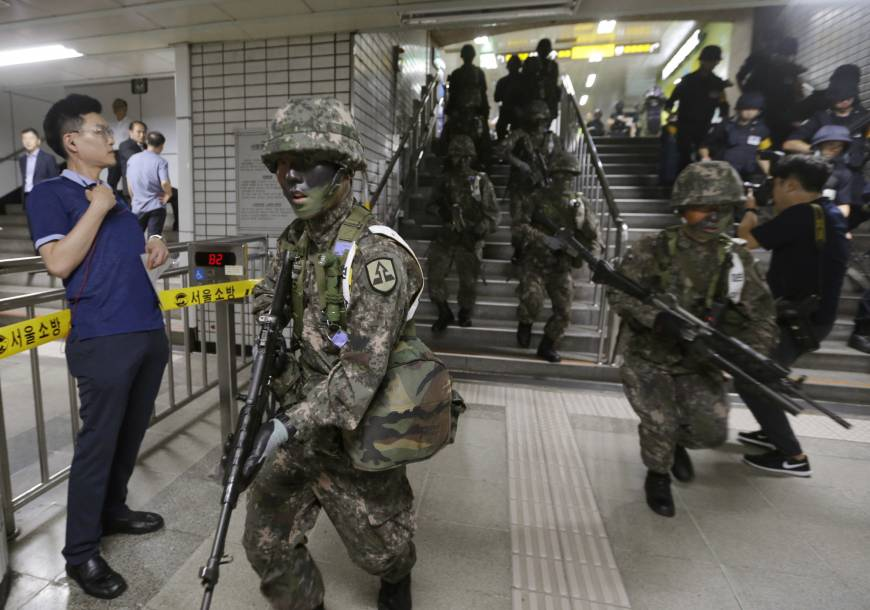 South Korea suspends civilian drills to help talks with North