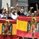People raise their hands and make a fascist salute near the tomb of late Spanish dictator Gen. Francisco Franco in San Lorenzo de el Escorial, near Madrid, on Sunday. They were attending a protest against the planned removal of Franco's remains, which are buried in the basilica there.