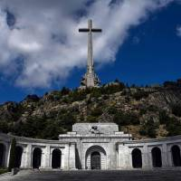A 150-meter cross stands atop a basilica at the tomb of Francisco Franco in the Valley of the Fallen, a monument to the Francoist combatants who died during Spain's civil war, in San Lorenzo del Escorial, near Madrid, on July 3. | AFP-JIJI