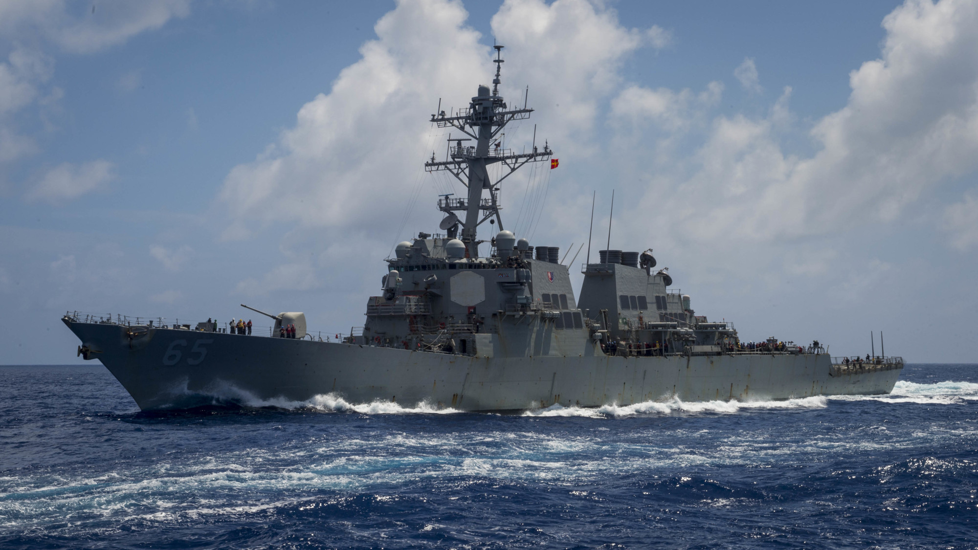 The Arleigh Burke-class guided-missile destroyer USS Benfold transits the Philippine Sea on June 14. | U.S. NAVY