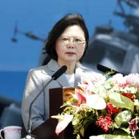 Taiwan President Tsai Ing-wen delivers a speech during a commissioning ceremony of the country's first AH-64E Apache attack helicopter squadron in Taoyuan City, Taiwan, on Tuesday. | AP