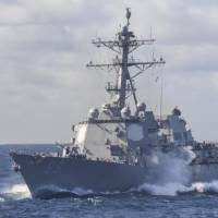 The Arleigh Burke-class guided-missile destroyer USS Mustin prepares for a replenishment at sea in the Indo-Asia-Pacific area on May 26. | U.S. NAVY