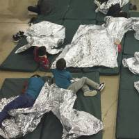 Teens taken at U.S. border tell of crammed 'icebox' and 'kennel' cages