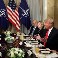 Trump and Merkel exchange barbs in showdown over Russia pipeline at start of NATO summit