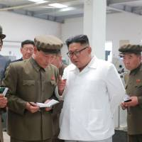 This undated picture released by North Korea's official Korean Central News Agency (KCNA) on Tuesday via KNS shows North Korean leader Kim Jong Un inspecting the September 1 Machine Factory under the Ranam Coal-mining Machine Complex in North Hamgyong Province. | KCNA VIA KNS / VIA AFP-JIJI