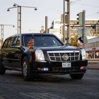 A presidential state car carrying U.S. President Donald Trump passes after the summit with Russia's President Vladimir Putin in Helsinki Monday. | LEHTIKUVA / ALEKSI TUOMOLA / VIA REUTERS
