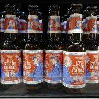 The label of Finnish beer brewery Rock Paper Scissors shows a cartoon of Russian President Vladimir Putin and U.S President Donald Trump, in a grocery store in Helsinki Wednesday. In a combative start to his NATO visit, Trump asserted Wednesday that a pipeline project has made Germany 'totally controlled' by and 'captive to Russia' and blasted allies' defense spending, opening what was expected to be a fraught summit with a list of grievances involving American allies. (Aku H'yrynen/Lehtikuva via AP)   AKU H'YRYNEN / LEHTIKUVA / VIA AP