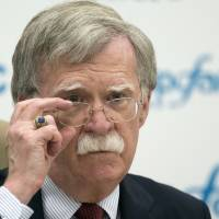 U.S. National security adviser John Bolton listens to question as he speaks to the media after his talks with Russian President Vladimir Putin in Moscow June 27.   AP