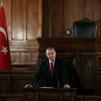Turkish President Tayyip Erdogan makes a speech at the old parliament building in Ankara on Friday. | REUTERS