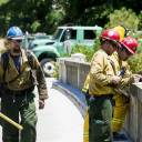 Fire crews keep watch on the Ferguson Fire from the South Fork Merced River Bridge on Highway 140 near El Portal in Mariposa County, California, on Saturday.