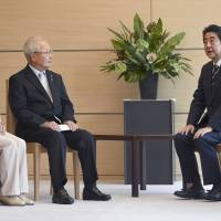 Prime Minister Shinzo Abe meets at his office last month with family members of victims abducted by North Korea. | KYODO